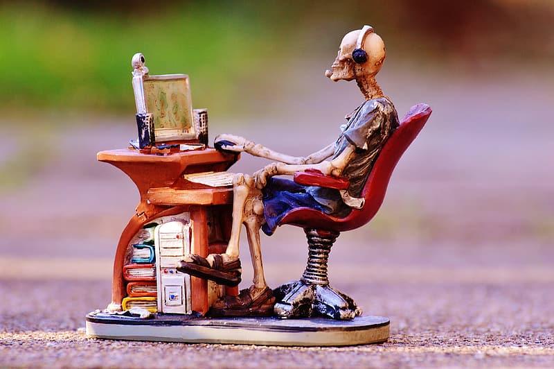 skeleton-sitting-in-front-of-desk